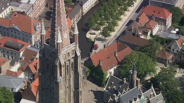 MS AERIAL View of Onze lieve Vrouekerk tallest spire in city / Flanders, Belgium