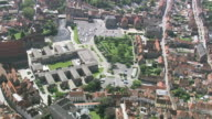 MS AERIAL DS View of Onze lieve Vrouekerk tallest spire in city / Flanders, Belgium