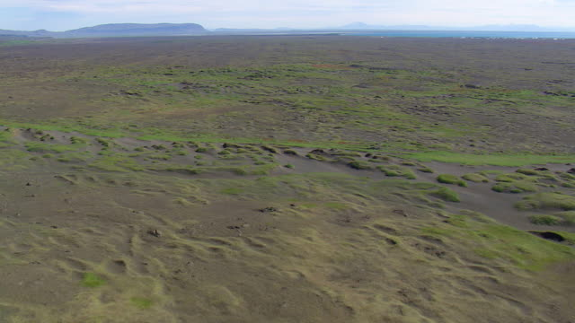 WS AERIAL View of open land near bay / Iceland
