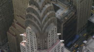 WS AERIAL DS View of Orbit Art Deco ornamentation and spire of Chrysler Building in Turtle Bay / New York, United States