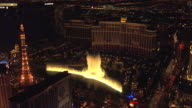 WS AERIAL TD View of orbit Bellagio water fountain show at night / Las Vegas, Nevada, United States