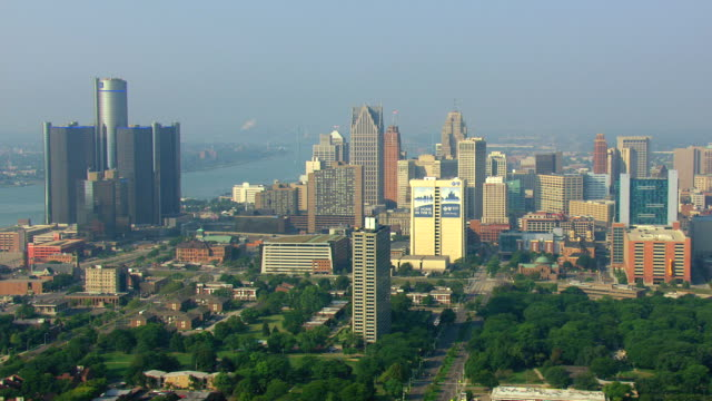 WS AERIAL View of  orbit Guardian Building and One Detroit Center skyline / Detroit, Michigan, United States