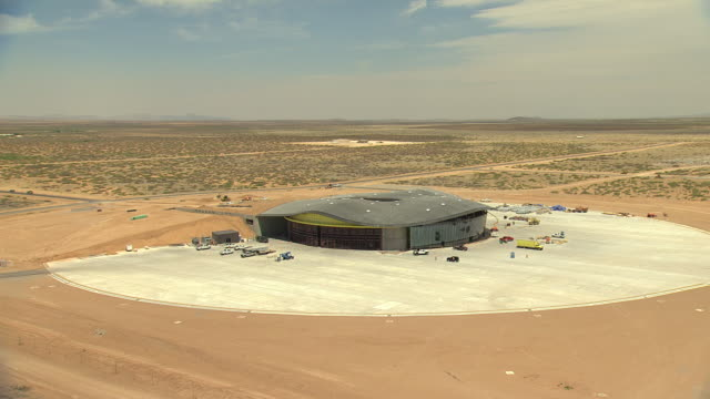 WS AERIAL View of orbit Spaceport America building in desert / New Mexico, United States