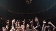 WS View of outstretched arms of fans at a rock & roll concert / Buenos Aires,  Argentina