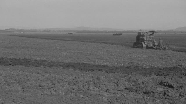 WS View of over plowed field, tractor enters