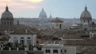 WS TU ZI View of over roof tops of buildings with Saint Peter Basilica in distance / Rome, Italy