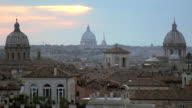 WS View of over roof tops of buildings with Saint Peter Basilica in distance / Rome, Italy