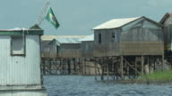 View of palafitte wooden houses during low tide at amazon - CLOSE UP CAM