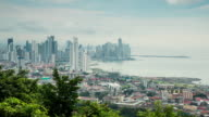 WS T/L View of panama City skyline in morning with clouds moving / Panama