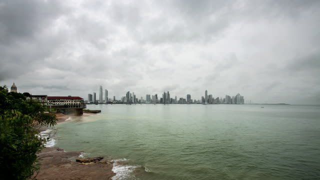 WS T/L View of panama city skyline seen from French plaza view point on stormy day / Panama