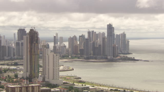 WS View of Panama City skyscrapers with dark gray clouds overhead / Panama