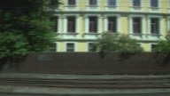 View of passing urban landscape from a train window.