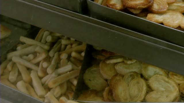 MS TU PAN View of pastries in bakery cabinet in Rio de Janeiro / Rio de Janeiro, Brazil