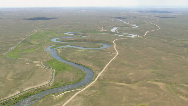 WS AERIAL ZI View of path of green river and dry landscape / Wyoming, United States