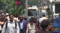 MS SLO MO View of Pedestrians walking on sidewalk and traffic in street / New York, United States