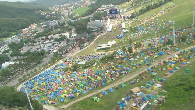 WS AERIAL View of People and Camp site in Jisan Valley rock Festival / Icheon, Kyonggi-Do Province, South Korea