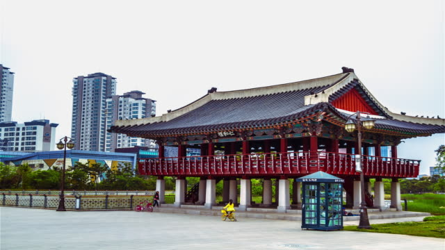 WS T/L POV View of People and Gazebo in the Michuhol Park in Songdo / Songdo, Incheon, South Korea