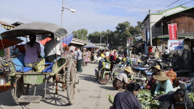 MS View of People and horse cart moving at Local Market / Nyaungshwe, Shan State, Myanmar