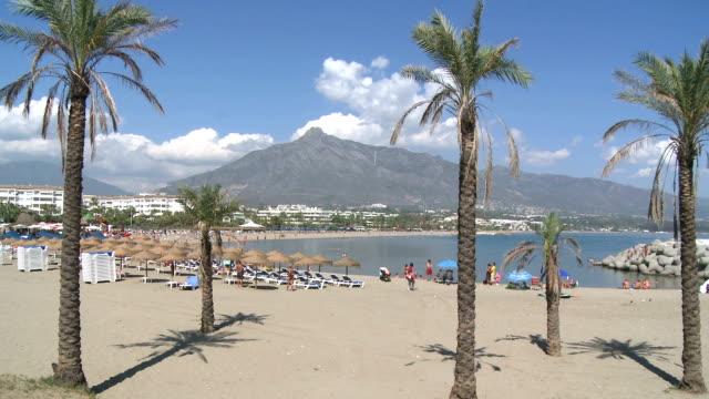 WS PAN View of people at beach in Puerto Banus / Marbella, Costa del Sol, Andalusia, Spain