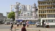 WS View of People crossing street at Bengali Sunni Jamae mosque / Yangon, Yangon Division, Myanmar