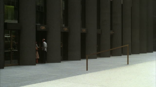 WS View of people entering and exiting office building