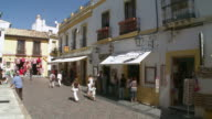 MS View of People moving in front of shop at Cordoba, old town / Cordoba, Andalusia, Spain