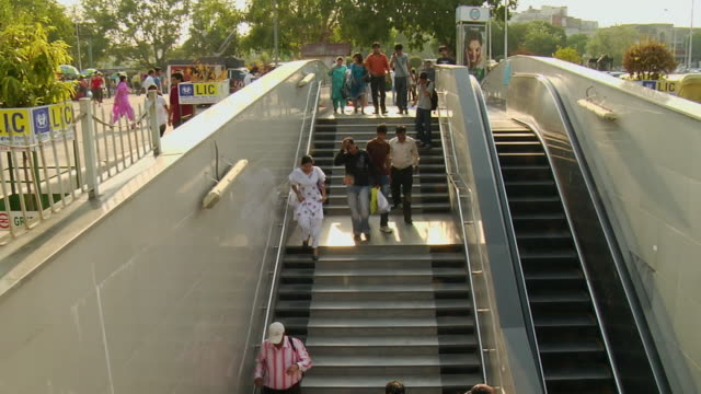 WS T/L View of people moving over an escalator / Delhi, India