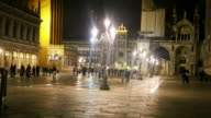 WS View of people on town square at night / Venice, Veneto, Italy