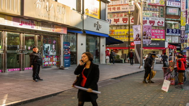 View of people passing through steet of Seomyeon (the biggest mainstreet in Busan)