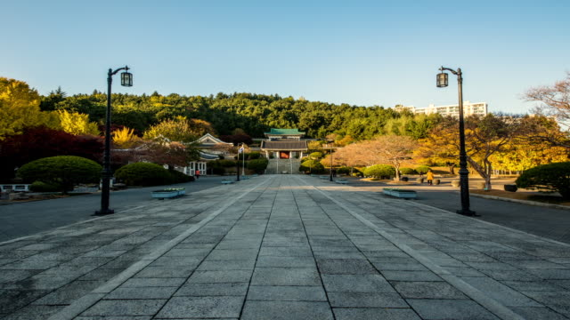WS T/L View of people roaming in Chungnyeolsa temple (keep an ancestral tablet in honor of the dead of Japanese Invasion of Korea in 1592 in a shrine) / Busan, Gyeongsangnam do, South Korea