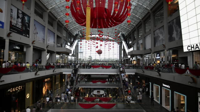 WS View of People shopping roaming in Marina bay sands shopping center / Singapore