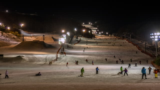 WS T/L View of People skiing in Pyeongchang (Host City of 2018 Winter Olympic Game) / Pyeongchanggun, Gangwon do, South Korea