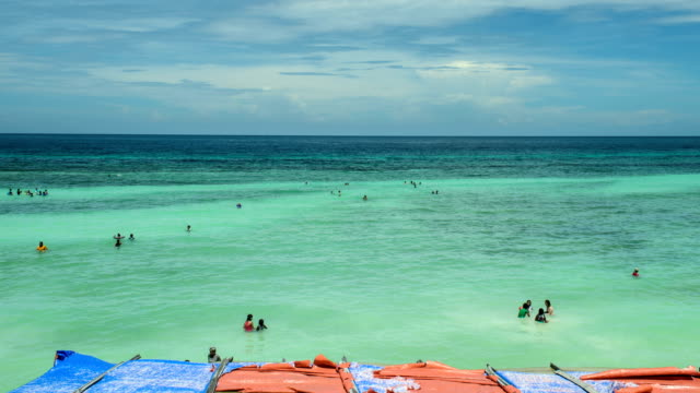 View of people swimming at Andy seaside of Bohol island