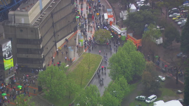 WS AERIAL ZI View of people walking at AFL stadium with raining / Deniliquin, New South Wales, Australia