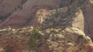 WS AERIAL DS View of people walking at peak of angels landing at Zion national park / Utah, United States