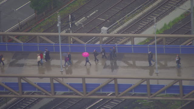 WS AERIAL ZI ZO View of people walking on bridge at AFL stadium / Deniliquin, New South Wales, Australia