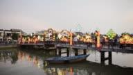 WS View of people walking on Bridge / Hoi An, Quang Nam, Vietnam