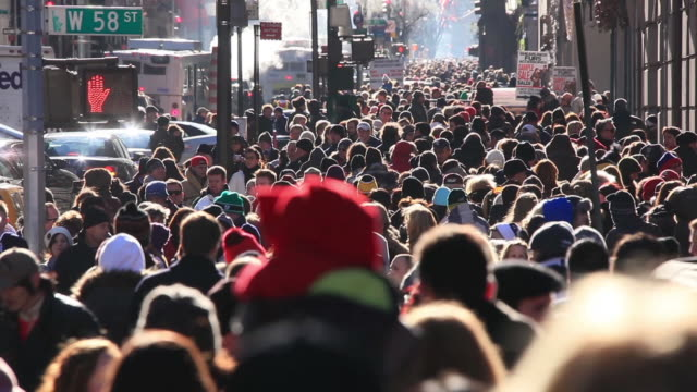 WS T/L View of people walking on crowd sidewalk at fifth avenue in Christmas seasons smoke blowing from street vender which surrounds people with traffic congestion / New York, United States