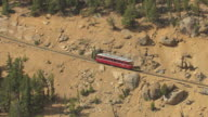 MS DS AERIAL View of pikes peak cog railroad driving up steep incline up mountain / Colorado, United States