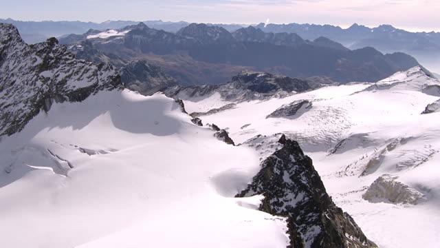 WS AERIAL PAN View of Piz gluschaint,cima sondrio, la sella and dschimels with piz roseg / Piz Gluschaint, Upper Engadin, Switzerland