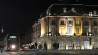 WS View of Place de la Bourse with tram in foreground at night / Bordeaux, Aquitaine, France.