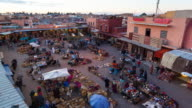 WS T/L View of place espice square at dusk with people moving / Marrakech, Morocco