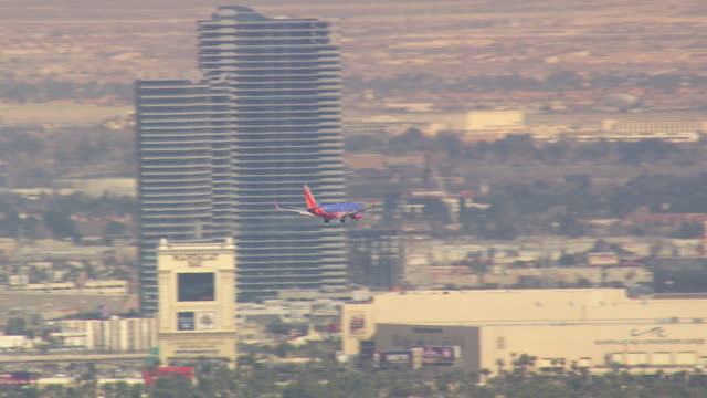 WS AERIAL View of Plane landing at airport / Nevada, United States