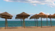MS View of Playa de La rada beach with beach hut/ Estepona, malaga, Spain