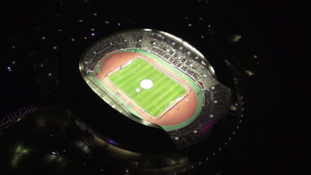 WS AERIAL View of playing soccer game in hwaseong sports complex at night / hwaseong, gyeonggi-do, South Korea