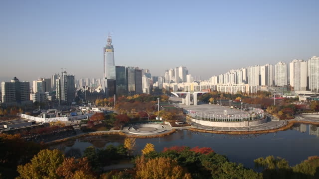 View of pond and World Peace Gate at Olympic Park in Songpa-gu