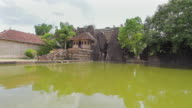 MS View of Pond in front of Isuruminiya Rock Temple / Anuradhapura, North Central Province, Sri Lanka