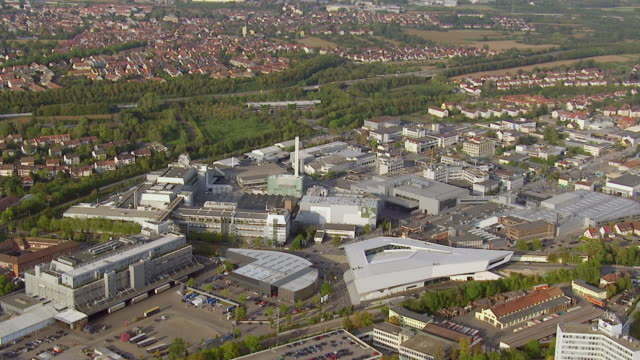 MS AERIAL ZO View of Porsche Museum and city / Stuttgart, Baden Wurttemberg