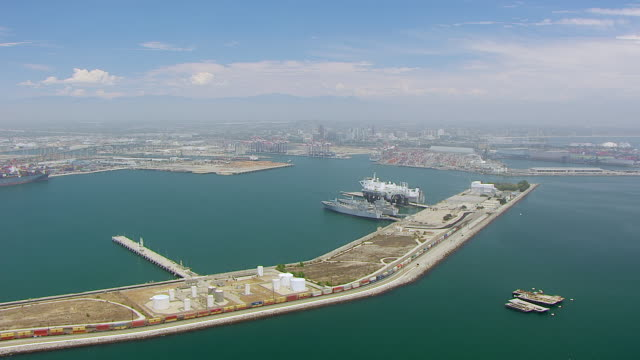 WS AERIAL POV View of Port of Los Angeles with Sea Launch Ship in background / Long Beach, California, United States