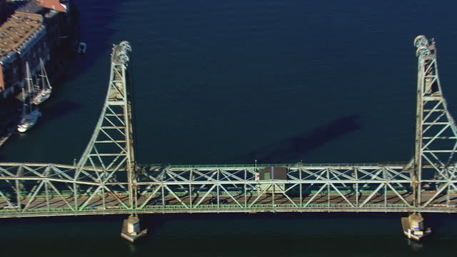 MS AERIAL ZI View of Portsmouth Harbor and cars moving on Memorial Bridge / New Hampshire, United States